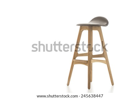 Single Tall Wooden Leg Stool Isolated on White Background. Emphasizing Copy Space. - stock photo