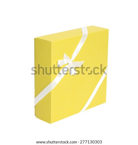 Single vertical yellow box with white ribbon on white background, cut out - stock photo