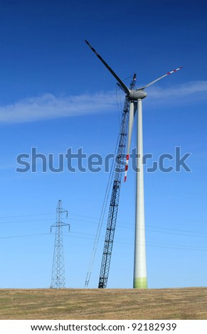 Single wind turbine under construction - stock photo