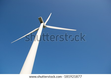 Single windmill for wind energy against blue sky - stock photo