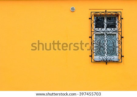 Single window on a orange wall with room for copy or text. - stock photo