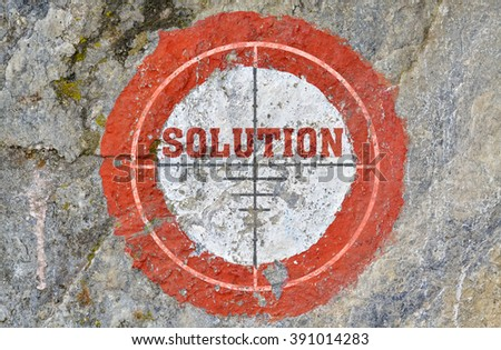 Single word Solution in the center of a red circle on textured background - stock photo