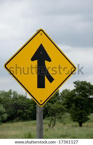 Single yellow and black merge sign - stock photo