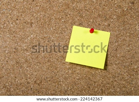 Single yellow New year Resolutions and reminder Post it Note in blank as copy space with red pin on message cork board - stock photo