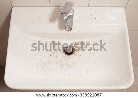 sink after shave with trimmer hair cut - stock photo