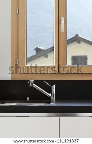 sink of modern kitchen with window - stock photo