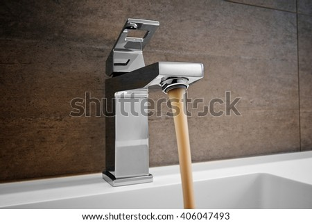 Sink Pouring Out Dirty Water, Water and droplets - stock photo