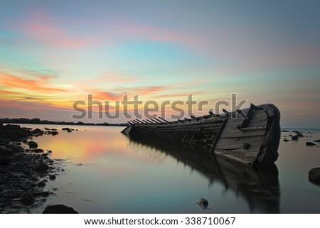 Sinking boat - stock photo