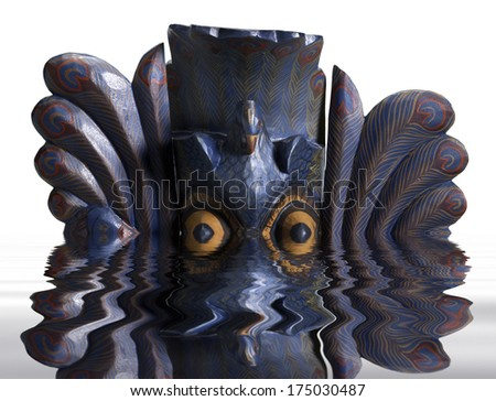 sinking colorful painted indigenous wooden mask on reflective water surface in white back - stock photo