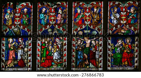 SINT-TRUIDEN, BELGIUM - APRIL 21, 2013: Stained glass window depicting scenes in the life of Mother Mary, in the Cathedral of Sint-Truiden in Limburg, Belgium. - stock photo