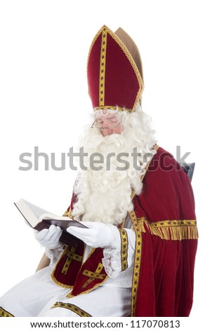 Sinterklaas is reading in his book - stock photo