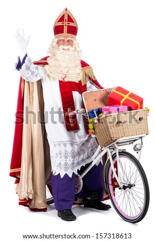 Sinterklaas on a bike, going to bring presents to the children - stock photo