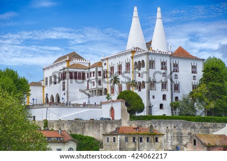 SINTRA, PORTUGAL - May 1, 2015: The National Palace in Sintra is a national landmark. With the two tall white kitchen chimneys, it was the royal family's country palace away from Lisbon. - stock photo