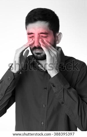 Sinus pain, sinus pressure, sinusitis. Sad man holding his nose because sinus pain - stock photo