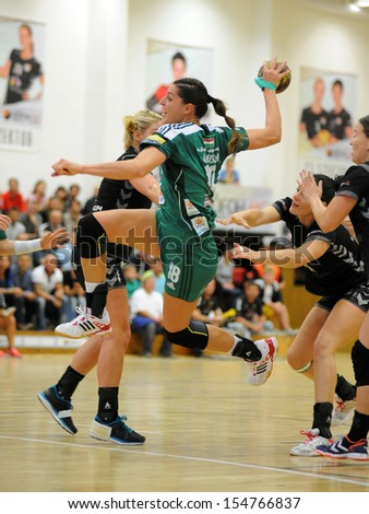 SIOFOK, HUNGARY - SEPTEMBER 14: Eduarda Amorim (in green) in action at a Hungarian National Championship handball match Siofok KC (black) vs. Gyor (green), September 14, 2013 in Siofok, Hungary. - stock photo