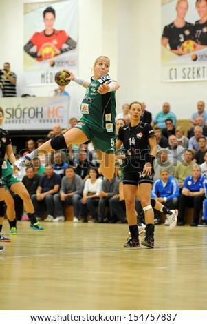 SIOFOK, HUNGARY - SEPTEMBER 14: Heidi Loke (green 5) in action at a Hungarian Championship handball match Siofok KC (black) vs. Gyori Audi ETO KC (green), September 14, 2013 in Siofok, Hungary. - stock photo