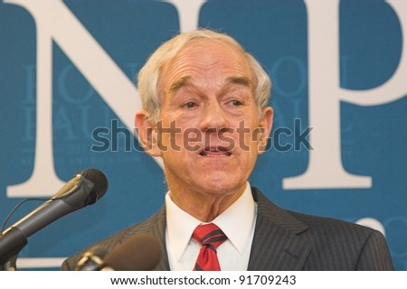 SIOUX CENTER, IA - DECEMBER 30: Presidential candidate Ron Paul addresses the crowd at a campaign stop in Sioux Center, IA on December 30, 2011. - stock photo