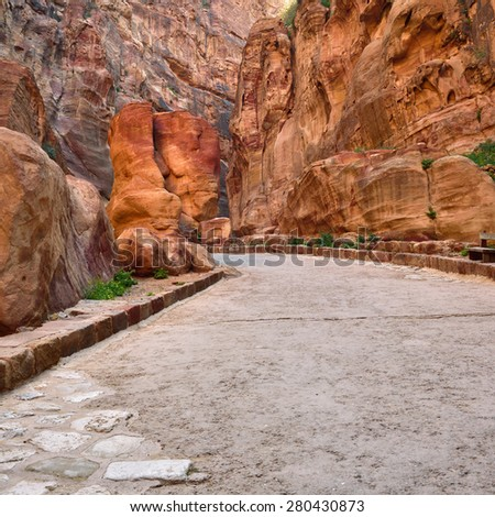 Siq gorge.  Way to the lost rock city Petra, Jordan. UNESCO world heritage site  - stock photo