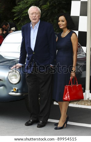 """Sir Michael Caine and wife, Shakira arriving for the """"Cars 2"""" pre premiere party at Whitehall Gardens, London. 17/07/2011 Picture by: Steve Vas / Featureflash - stock photo"""