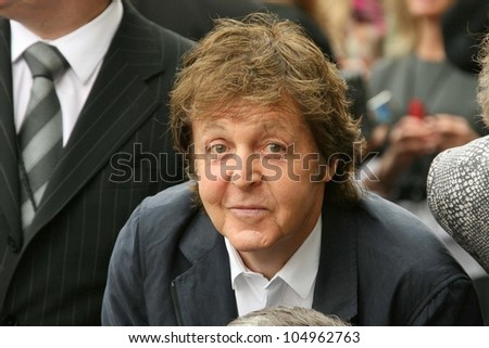 Sir Paul McCartney at the ceremony posthumously honoring George Harrison with a star on the Hollywood Walk of Fame. Vine Boulevard, Hollywood, CA. 04-14-09 - stock photo