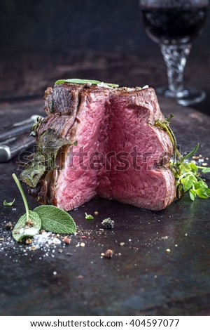 Sirloin Steak on old Sheet - stock photo