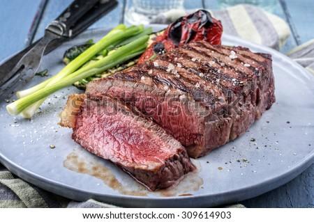 Sirlon Steak on Plate - stock photo