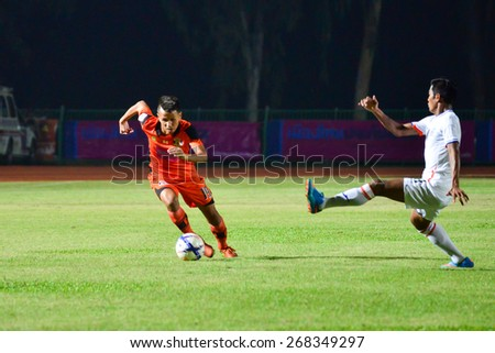 SISAKET THAILAND-APRIL 4: Jakkapong Somboon (orange) of Sisaket FC. in action during Thai Premier League between Sisaket FC and Thai Port FC at Sri Nakhon Lamduan Stadium on April 4,2015,Thailand - stock photo