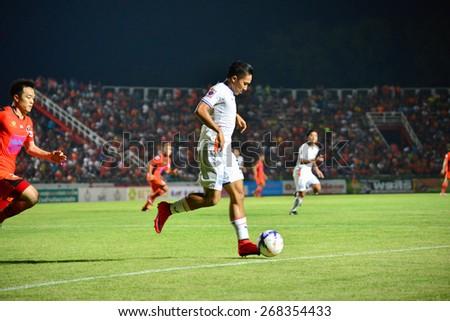 SISAKET THAILAND-APRIL 4: Prakasit Sansuk (White) of Thai Port FC. in action during Thai Premier League between Sisaket FC and Thai Port FC at Sri Nakhon Lamduan Stadium on April 4,2015,Thailand - stock photo