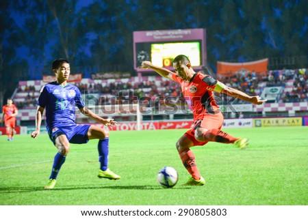 SISAKET THAILAND-JUNE 21: Akaphan Jandakorn (orange) of Sisaket FC. in action during  Thai Premier League between Sisaket FC and Navy FC at Sri Nakhon Lamduan Stadium on June 21,2015,Thailand - stock photo