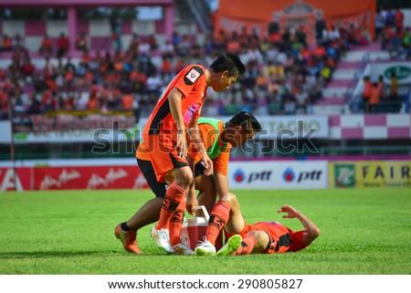 SISAKET THAILAND-JUNE 21: Player of Sisaket FC. injured during  Thai Premier League between Sisaket FC and Navy FC at Sri Nakhon Lamduan Stadium on June 21,2015,Thailand - stock photo