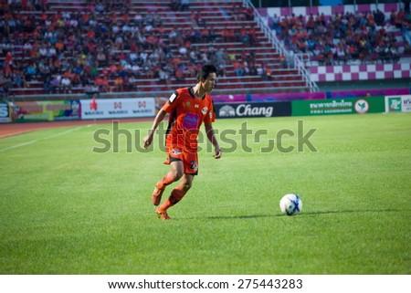 SISAKET THAILAND-MAY 3: Kittipong Wongma (orange) of Sisaket FC. in action during Thai Premier League between Sisaket FC and Chiang rai united at Sri Nakhon Lamduan Stadium on May 3,2015,Thailand - stock photo