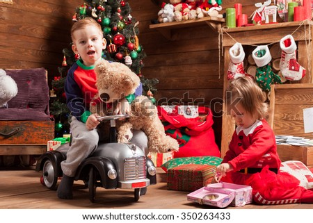 Sister and brother during Christmas holidays - stock photo