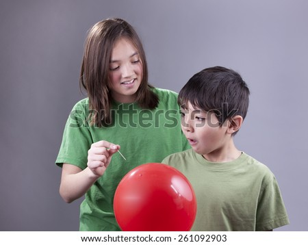 Sister caught by brother. - stock photo