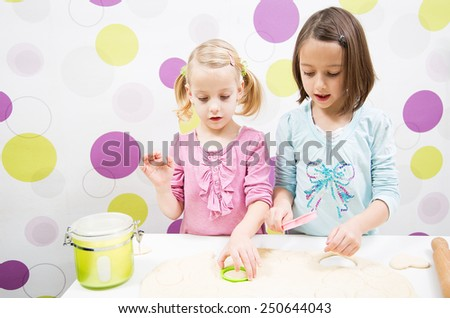 Sister making cake in kitchen - stock photo