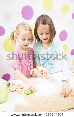 sister making cake, in kitchen - stock photo