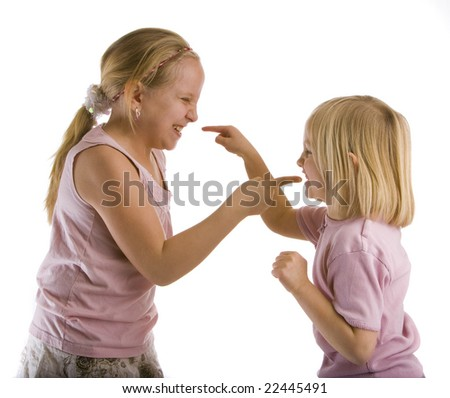Sisters arguing with pointed fingers wearing pink - stock photo