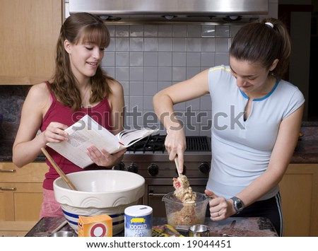 Sisters Cooking - stock photo