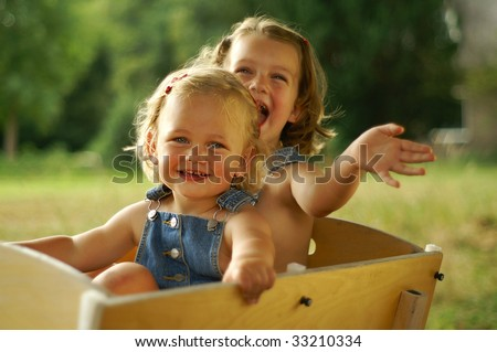 Sisters enjoying the ride - stock photo