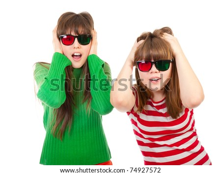 Sisters having fun while watching 3D movie isolated on white background - stock photo