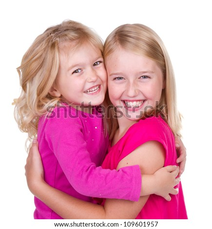sisters hugging isolated on white - stock photo