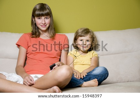 Sisters listening the music - stock photo