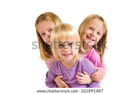 Sisters over white background - stock photo