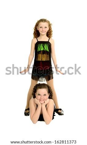 Sisters Pose in Tap Dancing Duo Recital Costume - stock photo
