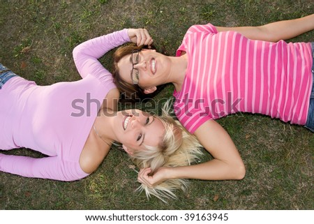 sisters relax in the park - stock photo