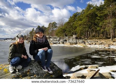 Sisters sea coast portrait - stock photo