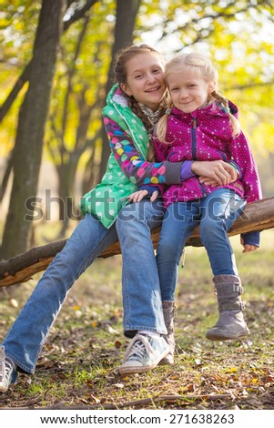 sisters, smiling tourist girls at the outdoors  - stock photo