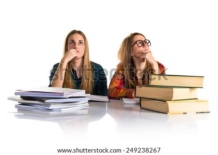 Sisters studying and thinking - stock photo