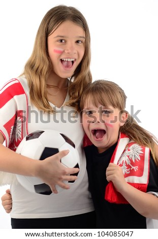 Sisters supporting Polish football team - stock photo