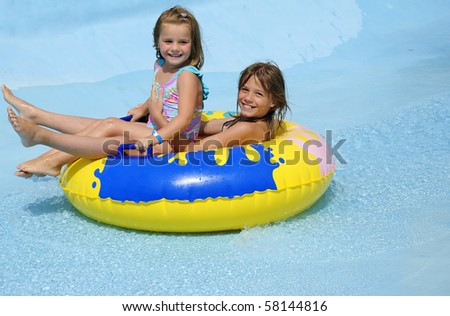 Sisters water fun - stock photo