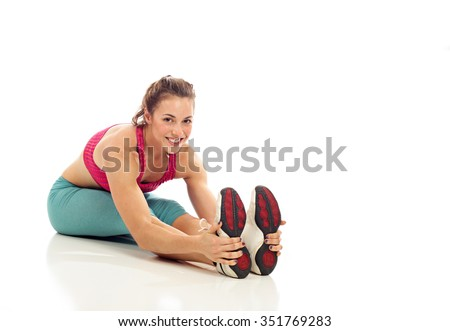 Sit and reach stretch on white background - stock photo